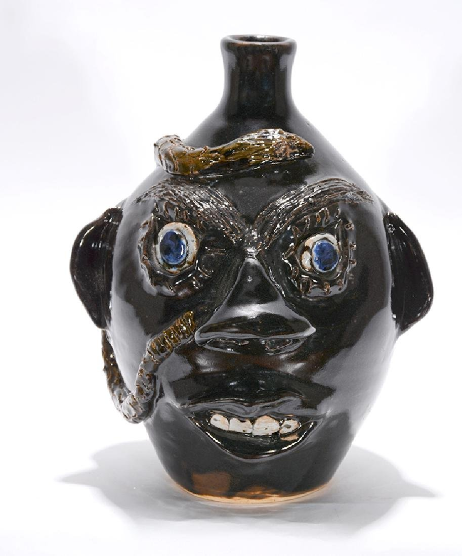 Jerry Brown. Black Face Jug With Snake.