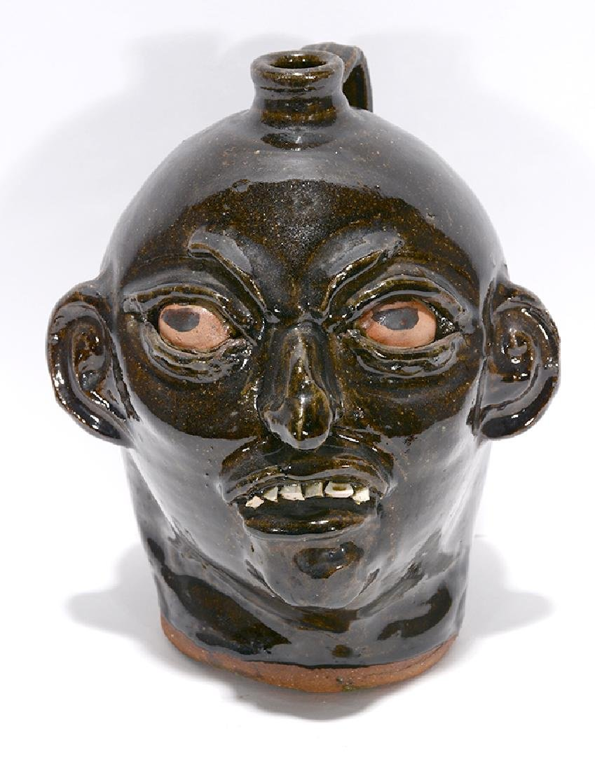 Chester Hewell. Early Face Jug.