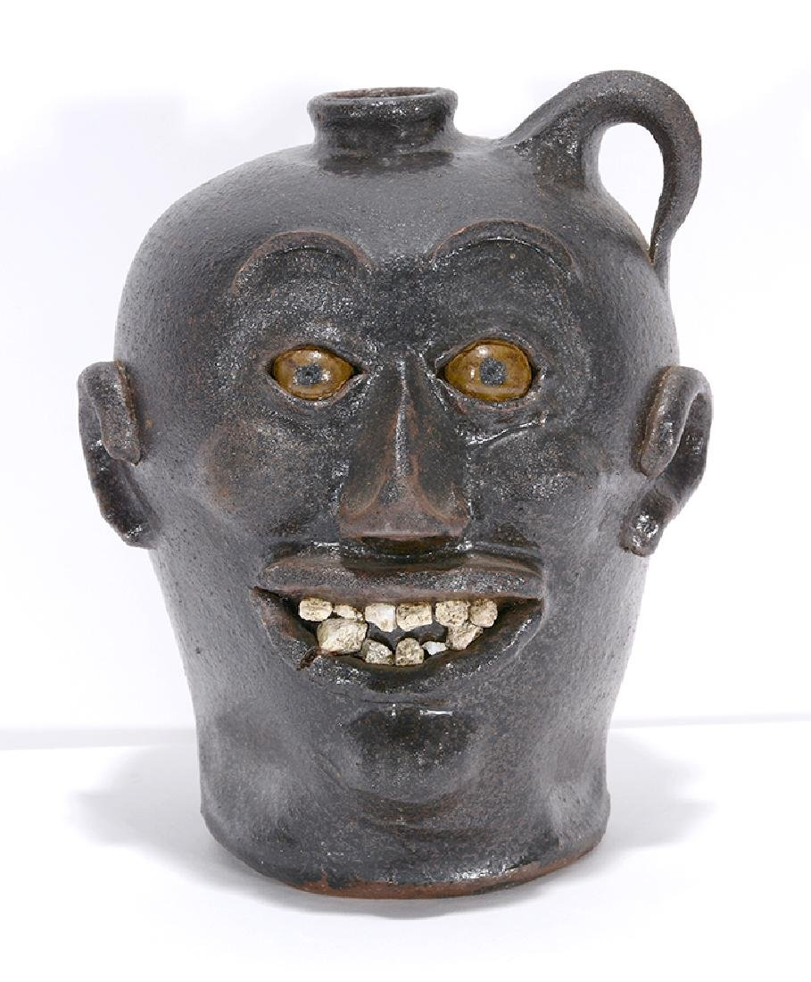 Charlie West. Rock Tooth Early Style Face Jug.