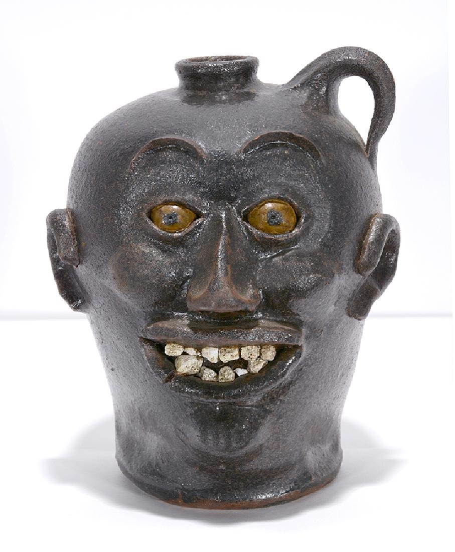 Charlie West. Rock Tooth Early Style Face Jug. - 2