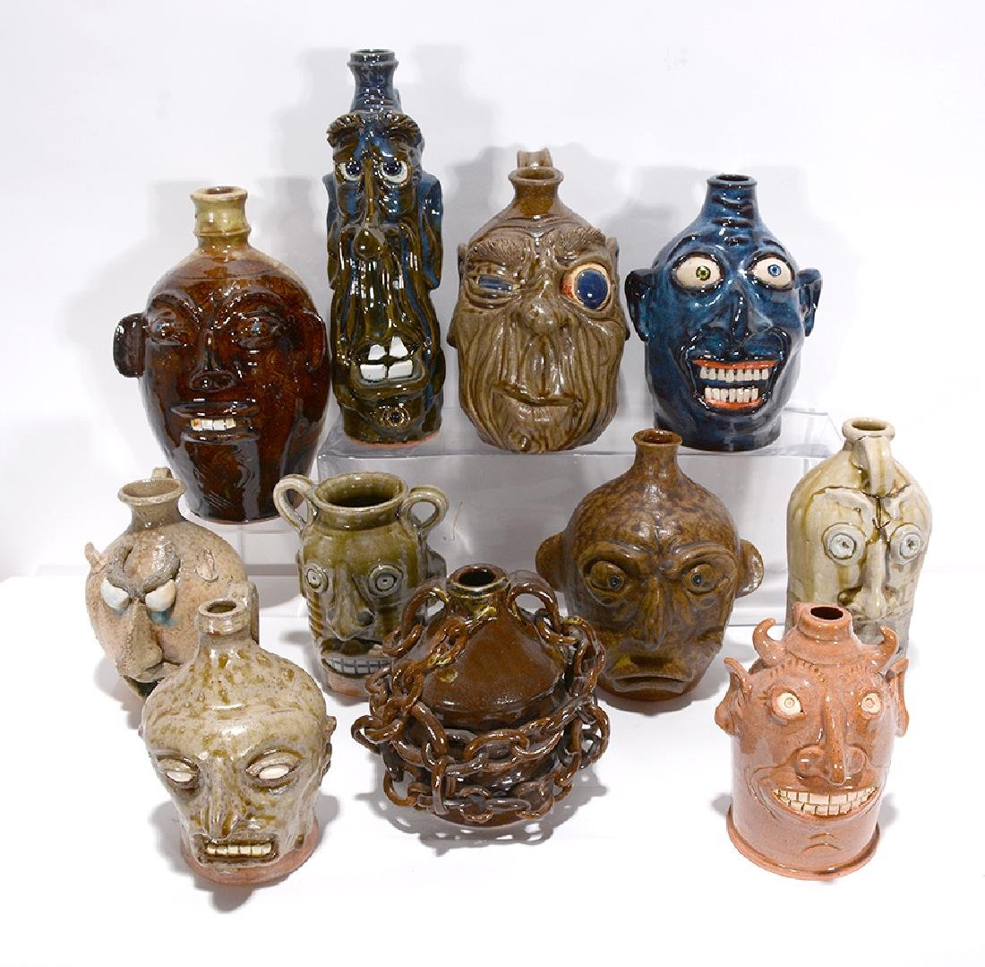 Mixed Potters. Eleven Face Jugs.