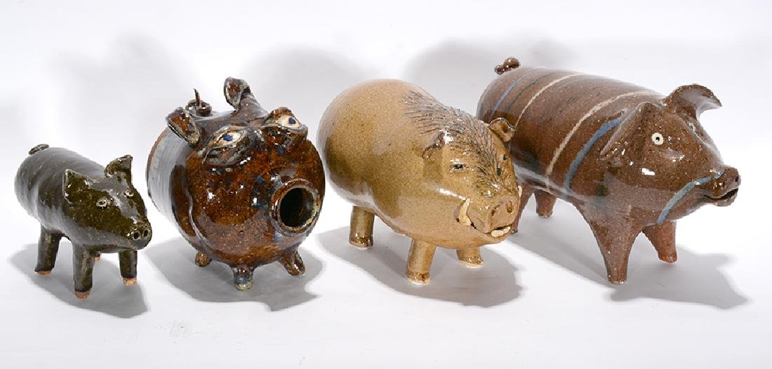4 Graduated Folk Pottery Pigs.