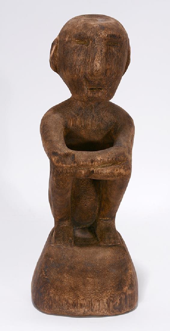 International Island Artist. Seated Man.