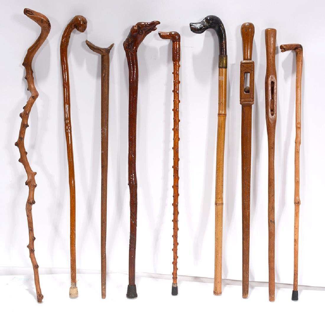 9 Carved Wooden Canes.