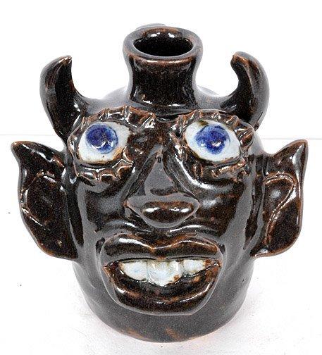 6: Jerry Brown. Devil Face Jug.
