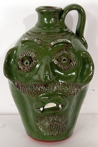 20: Bobby Ferguson Green Face Jug.