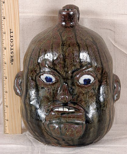 24: Chester Hewell Small Face Jug.