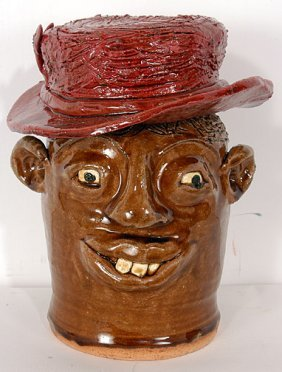 Reggie & Flossie Meaders Red Hat Face Jug.