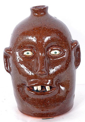 56: Reggie Meaders Face Jug w Missing Tooth.