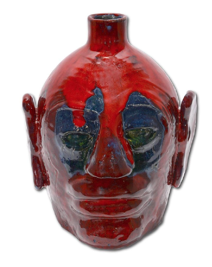 Edwin 'Nub' Meaders. Face Jug With Heavy Red Glaze.