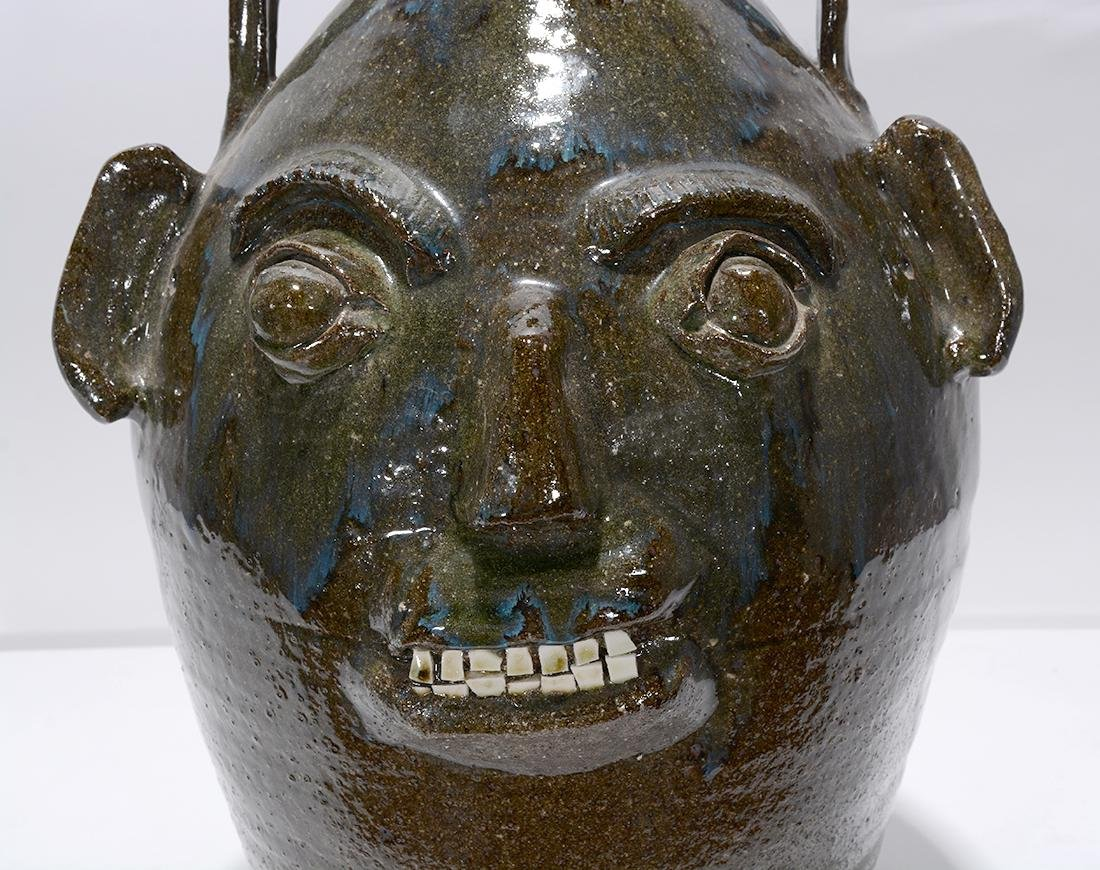 B.B. Craig. 5 Gal. Face Jug With Blue Routille Drips. - 4