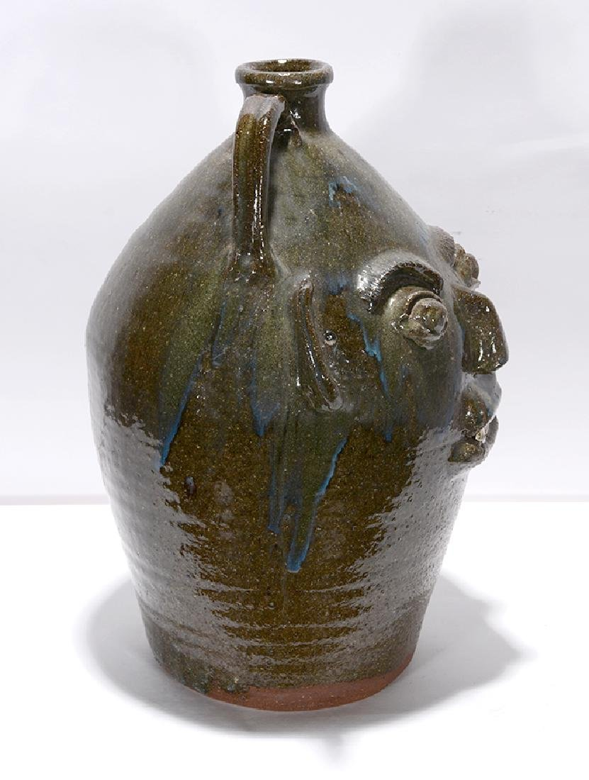 B.B. Craig. 5 Gal. Face Jug With Blue Routille Drips. - 5