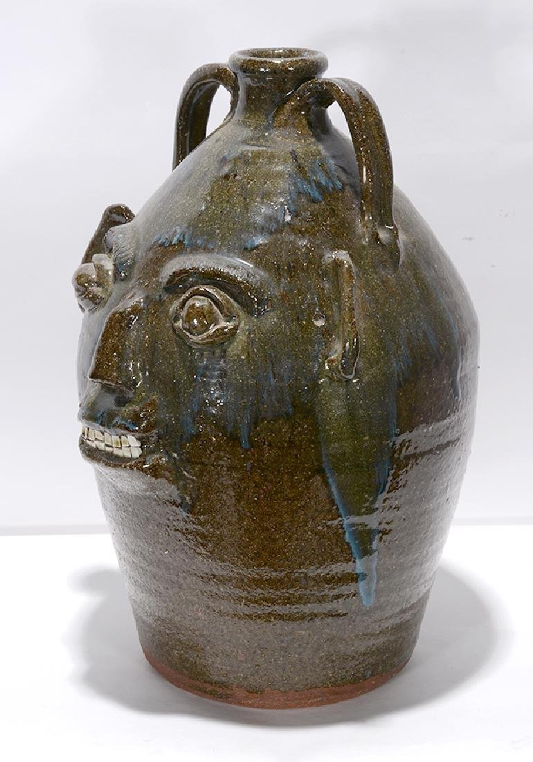 B.B. Craig. 5 Gal. Face Jug With Blue Routille Drips. - 7