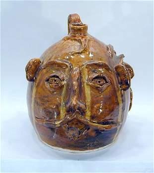 Ram Pottery Triple Face Jug