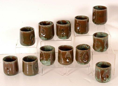 12: Daniel Cole Indention-Grip Mugs.