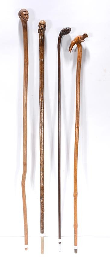 Four Canes With Heads & Animals.