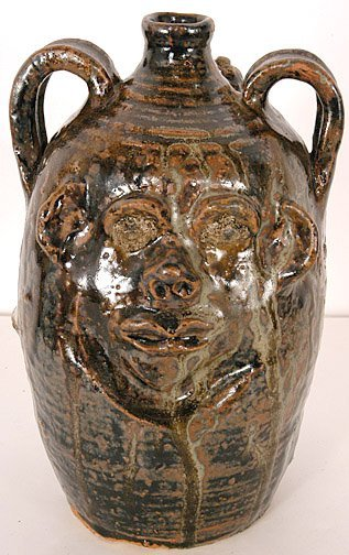 15: Marie Rogers. Face Jug With Snake