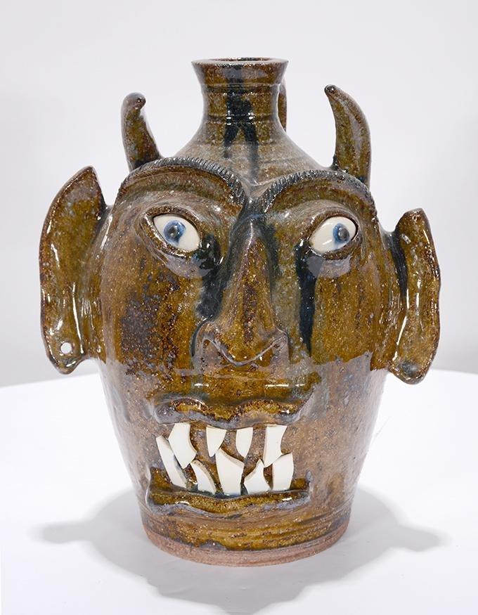 V. Lowery. Rare Brown Glaze Devil Face Jug.