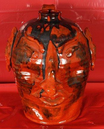 5: Turtle Creek Pottery, Rust Red Devil Jug