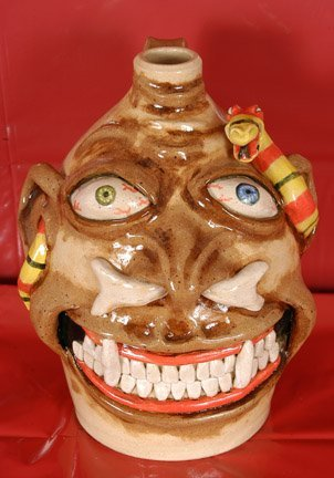 10: Stacy Lambert, Face Jug with a Snake.