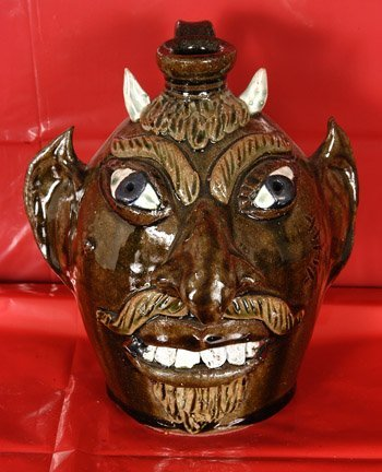 4: Albert Hodge. Green Devil Face Jug.