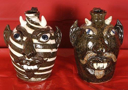 5: Albert Hodge. 2 Devil Face Jugs.