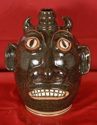 8: Karen LaBarga. Dk. Green Devil Face Jug.