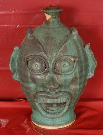 9: Karen LaBarga. Green Devil Face Jug.