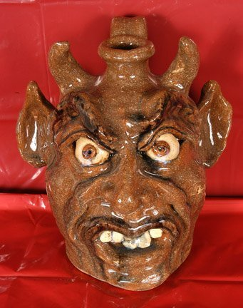 11: W.A. Flowers. Green Red Devil Face Jug.