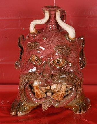 14: Josh Boolk. Red Devil Face Jug w Feet.