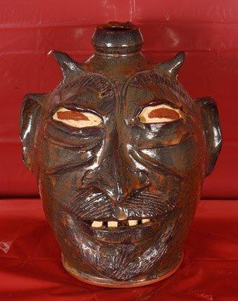22: D.B. Voll. Dark Rust Devil Face Jug
