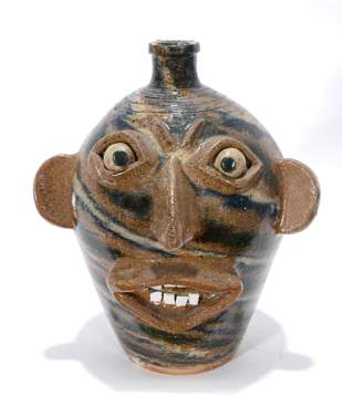 G.M. Multi-Colored Swirl Face Jug.