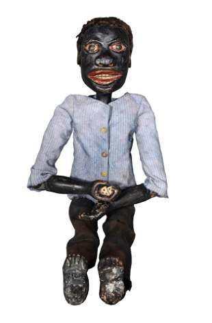 Anonymous African American Doll Throwing Dice.