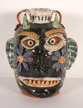 1: Flatland Pottery Devil Face Jug.
