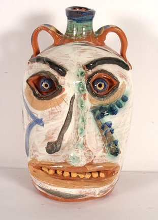 2: Flatland Pottery. Face Jug w Floral Decor.
