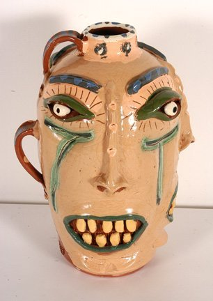 3: Brock Pottery. Triple Face Jug.