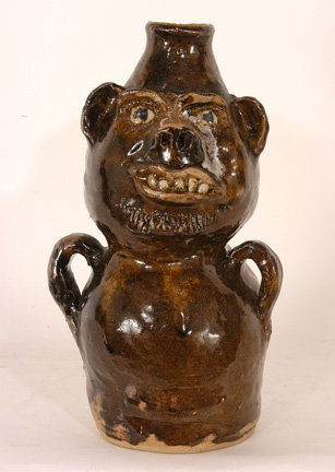 16: Marie Rogers. Brown Totem Face Jug.