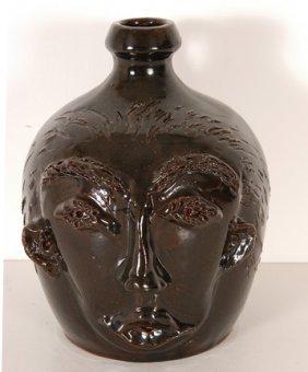 Cole Pottery. Dark Face Jug.