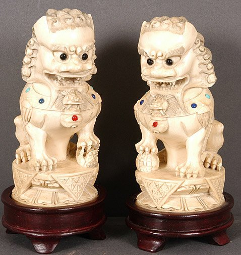 924: Pair of Asian Lion Statuettes.