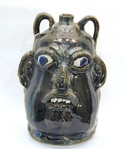 24: Chester Hewell Double Face Jug