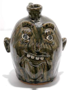 Clete Meaders. Crooked Smile Face Jug.