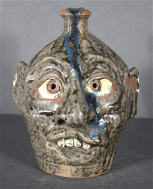 William Flowers. Face Jug With Glass Drips.