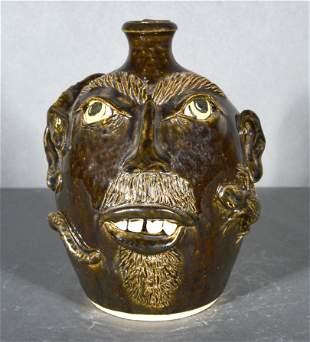 J.S. Pottery. Face Jug With Snake & Lizard.