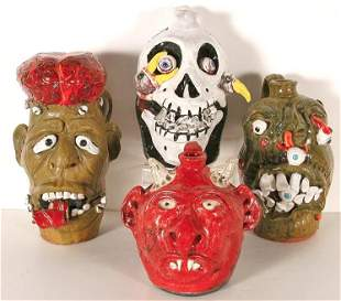 Mike Hanning. 4 Grotesque Face Jugs.