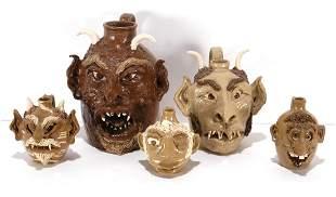 N. Cole Family Pottery. 5 Face & Devil Jugs.