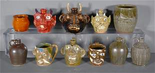 11 Mini Jugs by Various Potters.