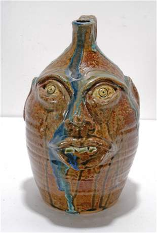 William Flower. Face Jug With Blue Glass Drips.