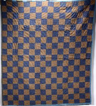 Blue and Brown Checker Board Quilt.