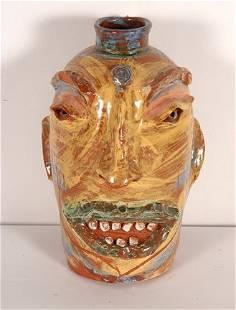 Flatland Pottery. Smiling Green-Lipped Face Jug.