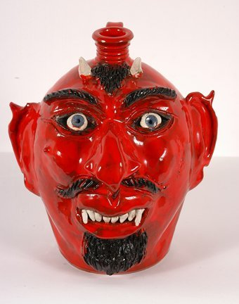 7: Albert Hodge.  Red Devil Face Jug.